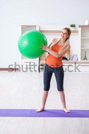 The young woman exercising with swiss ball in health concept Stock photo © Elnur