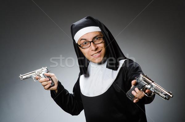 Uomo suora pistola ragazza chiesa culto Foto d'archivio © Elnur