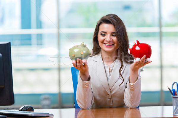 Businesswoman sitting at the office desk Stock photo © Elnur