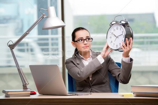 Businesswoman failing to meet challenging deadlines Stock photo © Elnur