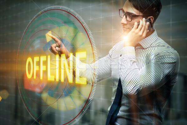 Businessman pressing virtual button offline Stock photo © Elnur