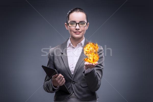 Businesswoman holding burning american dollar sign Stock photo © Elnur