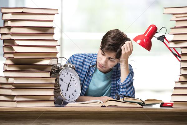Fiatal diák iskola vizsgák könyvek óra Stock fotó © Elnur
