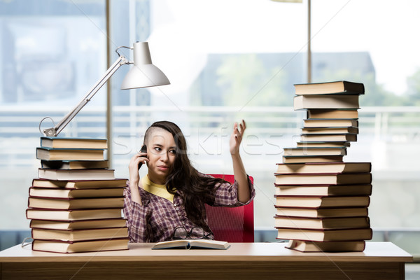 Young student with stack of books Stock photo © Elnur