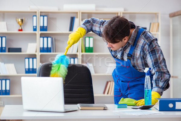 Male cleaner working in the office Stock photo © Elnur
