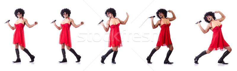 The man in female clothing singing with mic Stock photo © Elnur