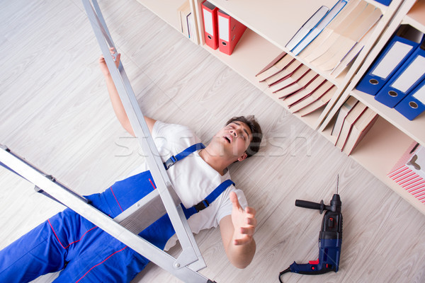 The unsafe behavior concept with falling worker Stock photo © Elnur