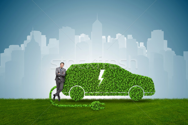 Businessman in green electric car concept Stock photo © Elnur