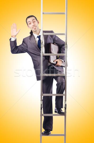 Businessman climbing the ladder isolated on white Stock photo © Elnur