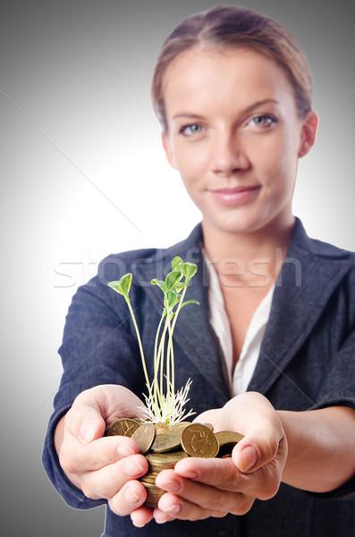 Femme d'affaires semis pièces fleur nature feuille Photo stock © Elnur