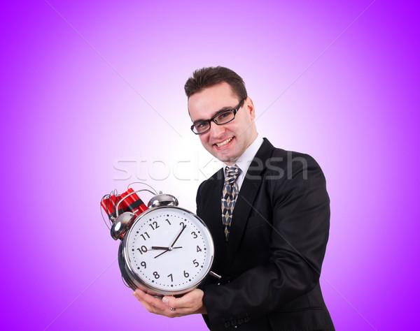 Man with time bomb against the gradient Stock photo © Elnur