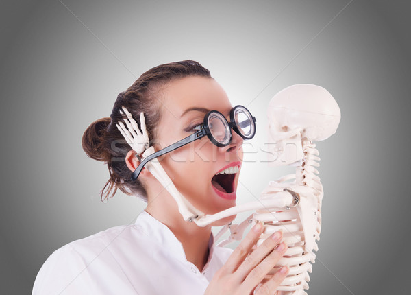 Doctor with skeleton against gradient  Stock photo © Elnur