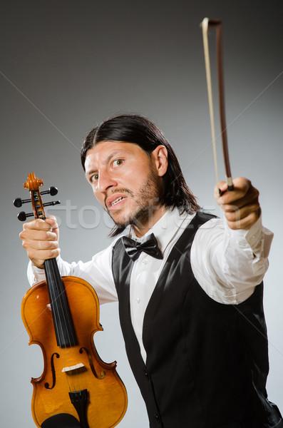Homem jogar violino musical arte engraçado Foto stock © Elnur