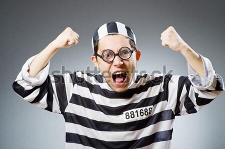 Young prisoner against gray Stock photo © Elnur