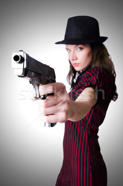 Stock photo: Woman gangster with handgun on white
