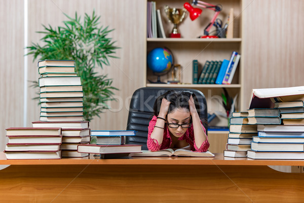 Stock photo: Young female student preparing for college school exams