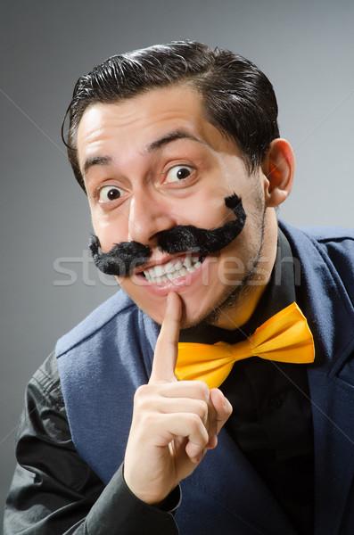 Funny man against dark background Stock photo © Elnur