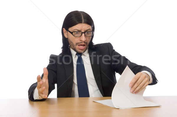 Businessman with document on the table isolated on white Stock photo © Elnur