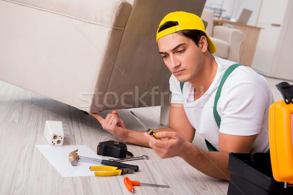 The furniture repairman repairing armchair at home Stock photo © Elnur