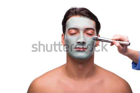 Man with face mask being applied on white Stock photo © Elnur