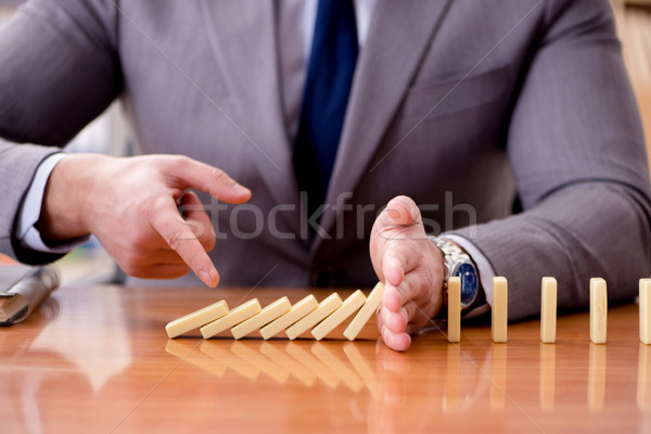 The businessman with dominoes in the office Stock photo © Elnur