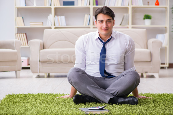 Businessman sitting on the floor in office Stock photo © Elnur