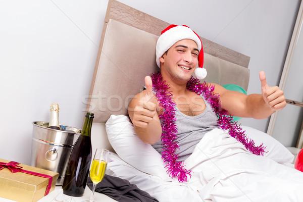 Człowiek kac późno imprezy biuro wina Zdjęcia stock © Elnur