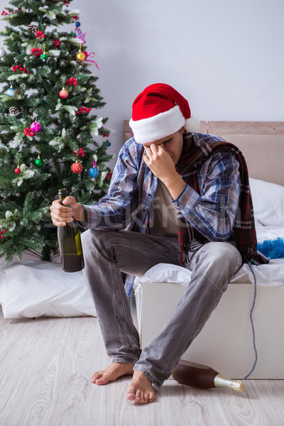 Stock photo: Man suffering hangover after christmas party