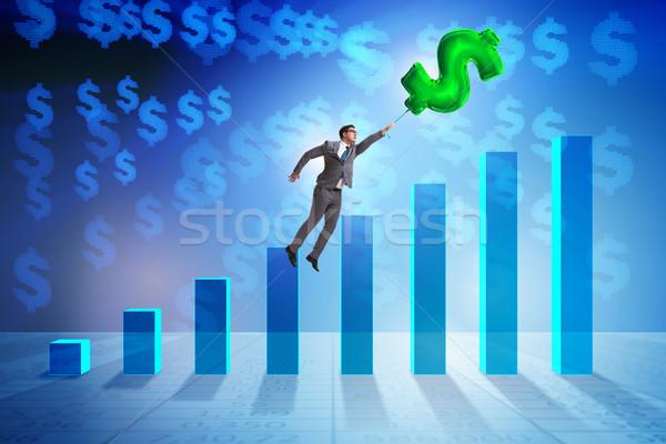 бизнесмен Flying знак доллара надувной шаре Сток-фото © Elnur