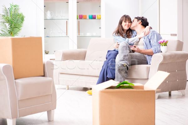 Fiatal család mozog új lakás fizet Stock fotó © Elnur
