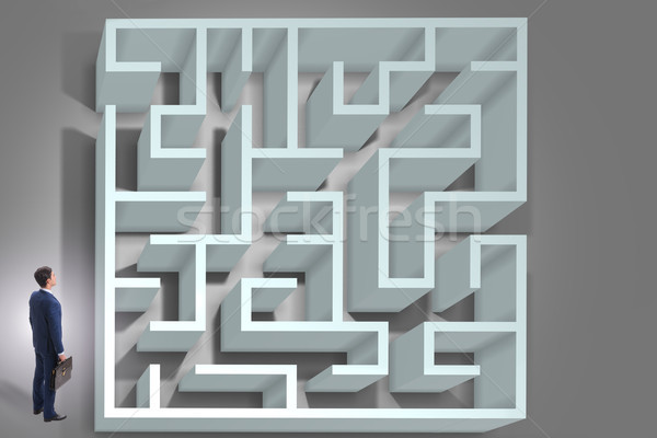 Businessman is trying to escape from maze labyrinth Stock photo © Elnur
