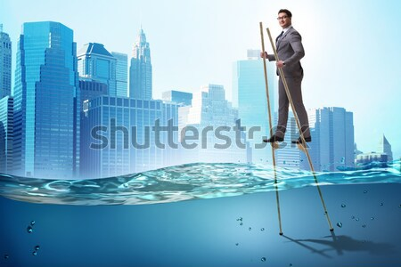Drowning businessman in insolvency and bankruptcy concept Stock photo © Elnur