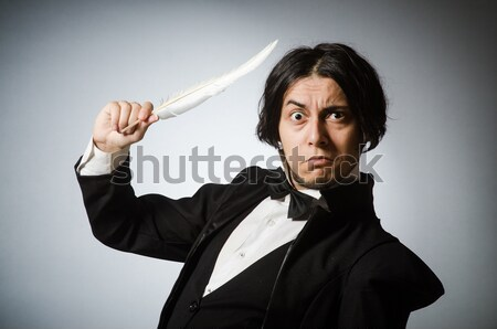 Angry businessman with sword in dark room Stock photo © Elnur