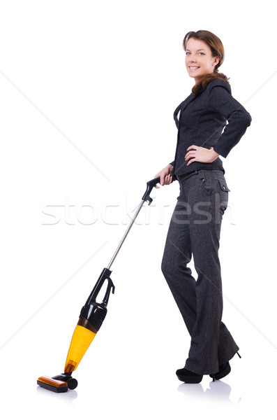 Stock photo: Young woman doing vacuum cleaning