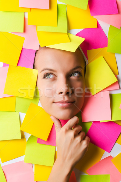 Businesswoman with lots of reminder notes Stock photo © Elnur