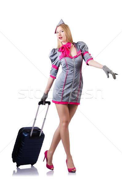 Airhostess with luggage on white Stock photo © Elnur