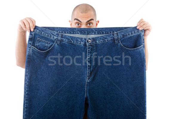 Férfi diétázás túlméretezett farmer boldog egészség Stock fotó © Elnur