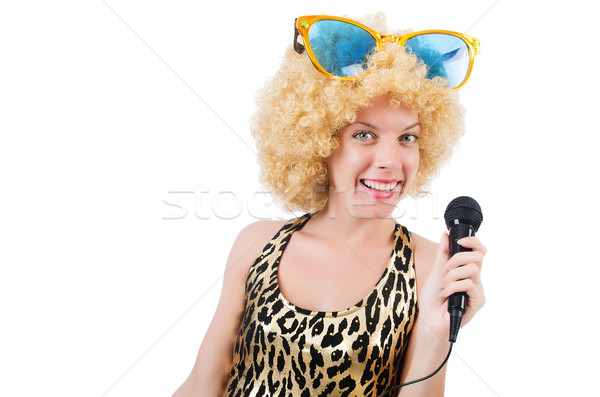 Stock photo: Funny singer   woman with mic and sunglasses  isolated on white