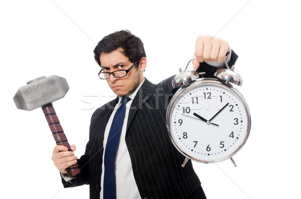 Businessman holding hammer and alarm clock isolated on white Stock photo © Elnur