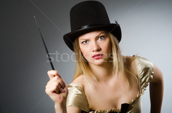 Woman magician with magic wand and hat Stock photo © Elnur