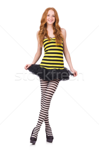 A girl in black and yellow striped dress isolated on white Stock photo © Elnur