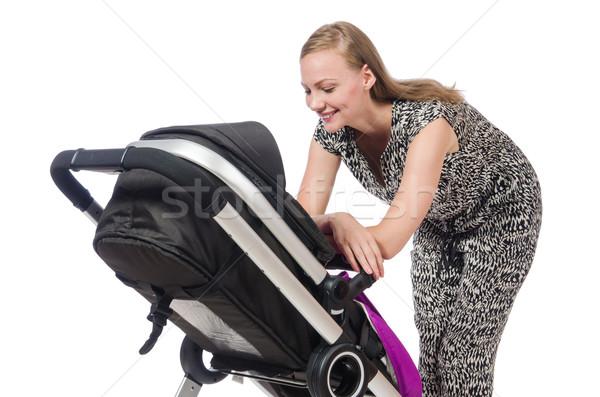 Happy mom with her baby in pram Stock photo © Elnur