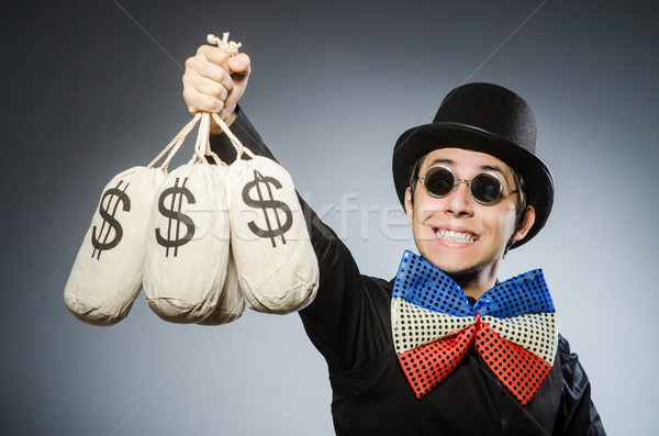 Funny man with money dollar sacks Stock photo © Elnur