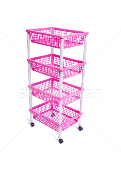 Pink bin rack shelf with wheels isolated on white Stock photo © Elnur