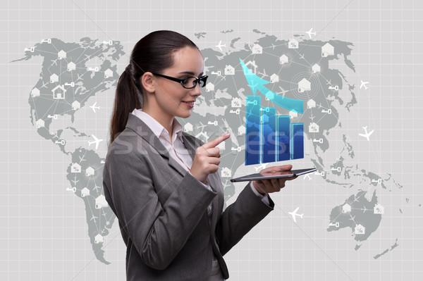 Woman trader with tablet and chart Stock photo © Elnur