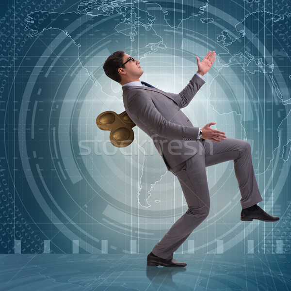 Businessman with key in hardworking concept Stock photo © Elnur