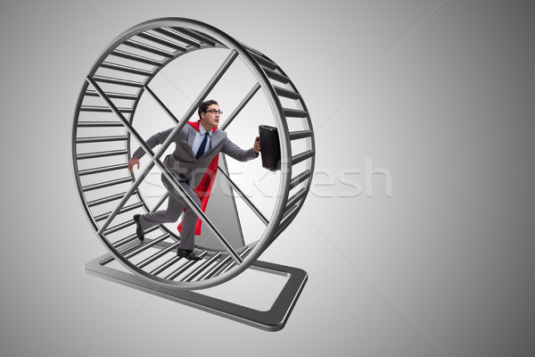 Businessman running on hamster wheel Stock photo © Elnur