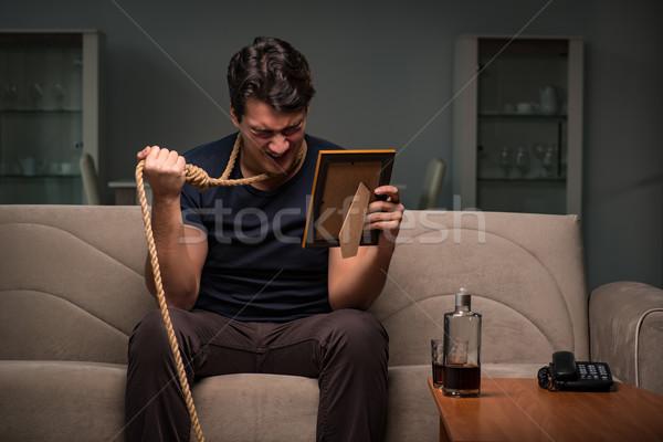 Kétségbeesett férfi gondolkodik öngyilkosság pár szomorú Stock fotó © Elnur