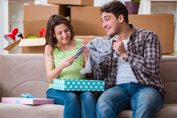 The young couple of man and pregnant wife with giftbox Stock photo © Elnur
