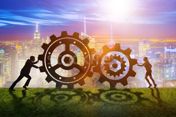 Businesspeople in teamwork example with cogwheels  Stock photo © Elnur